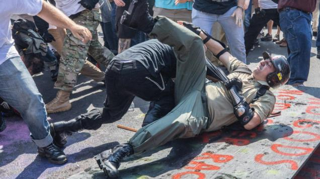 Clashes between protesters and counter protestors erupt during the Unite the Right rally in Charlottesville, Va., on Saturday. MUST CREDIT: Photo for The Washington Post by Evelyn Hockstein